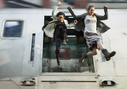 Tris learns the true meaning of friendship: jumping off things while holding hands.