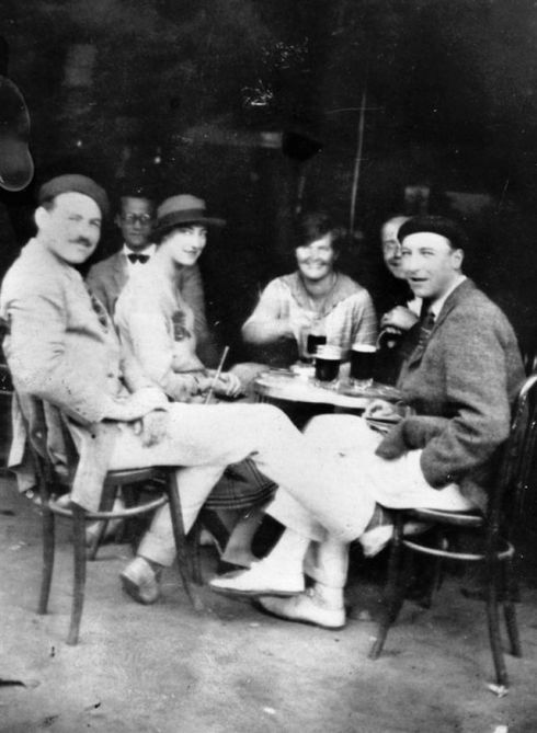 Hemingway's own trip to Spain inspired TSAR. Here he is (far left) in café in Pamplona sitting next to Lady Duff Twysden, the inspiration for Lady Brett Ashley. (From Wikipedia)
