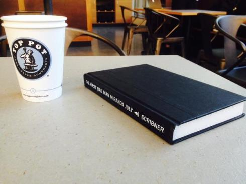 I realize this may become a trend: taking photos of my book with my coffee. Get used to it, folks.